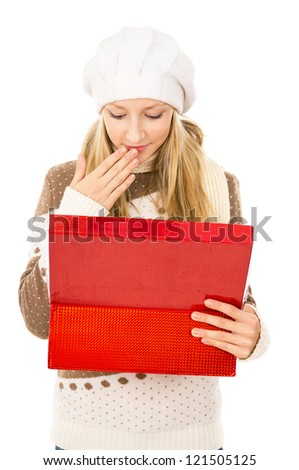 girl looks in a gift box and wondering - stock photo