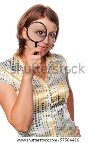 Girl looks through a magnifier - stock photo