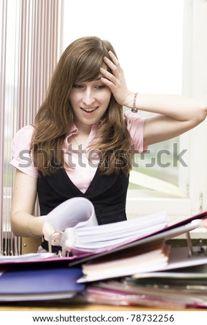 Girl looks troubled at the office - stock photo