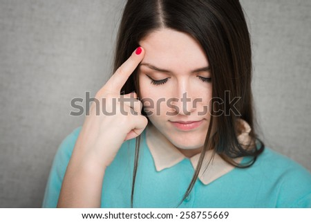 girl lowered her head and thought - stock photo