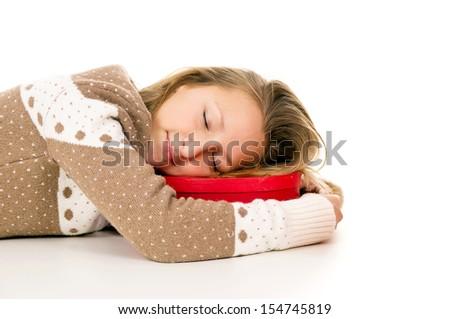 girl lying and sleeping on the box - stock photo