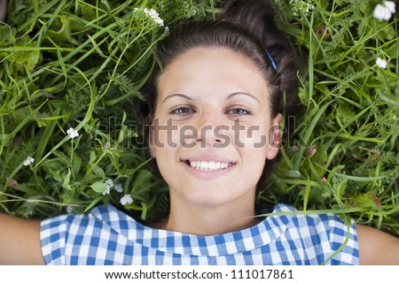 girl lying on a lawn - stock photo