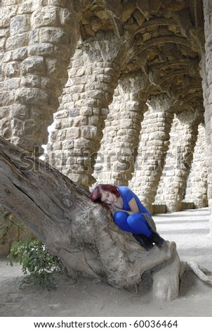 girl lying on a tree in Barcelona - stock photo