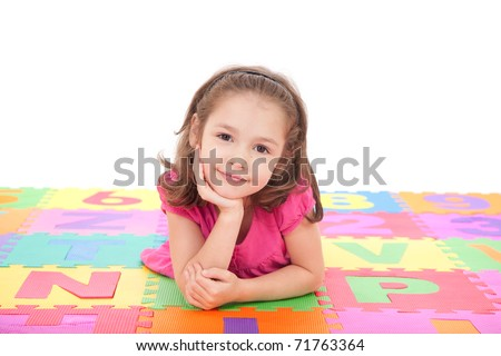 Girl lying on colorful mat resting head on hand. Isolated on white - stock photo
