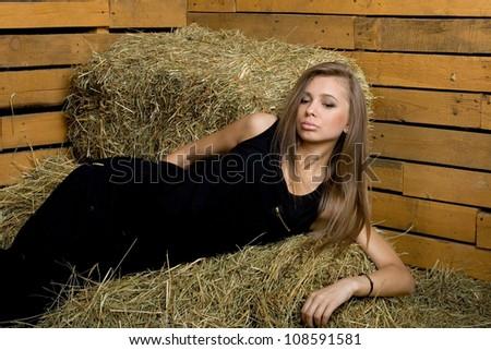 Girl lying on hay - stock photo