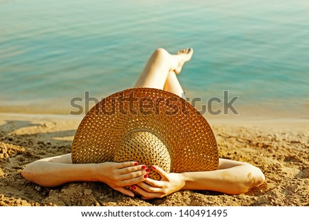 girl lying on the beach - stock photo