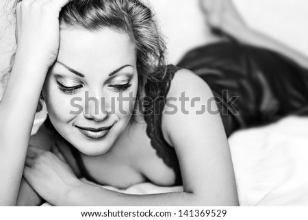 girl lying on the bed - stock photo