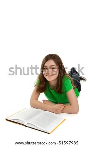 Girl lying, reading book - stock photo