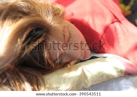 Girl lying with shining hair blessing on sunshine