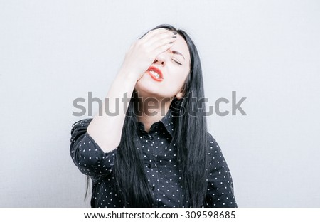 girl made a mistake, covers face with her hands - stock photo