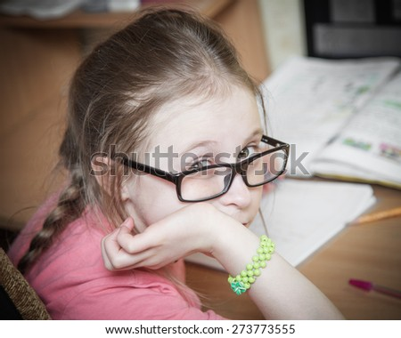 Girl make written lessons at home. - stock photo