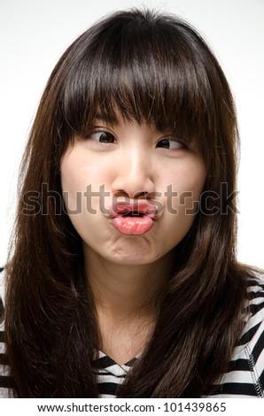 Girl makes a crazy funny face - stock photo