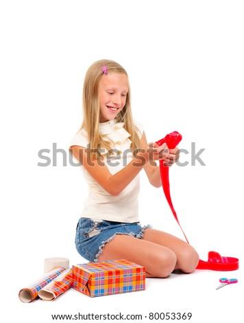 Girl makes a gift on a white background isolated