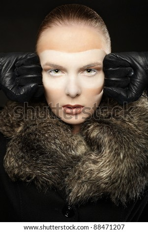 Girl makeup masked beauty with white colour isolated on black - stock photo