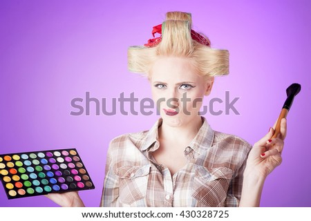 Girl makeup on purple background