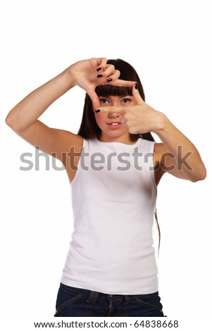 Girl making a frame with her hands - stock photo