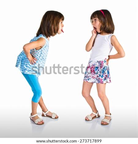 Girl making a joke at her sister - stock photo