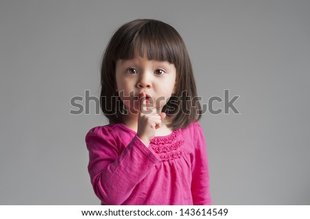 Girl Making A Keep Quiet Gesture - stock photo
