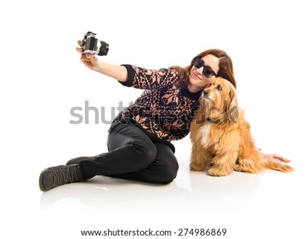 Girl making a selfie with her dog - stock photo