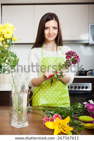 Girl making  beautiful bouquet of flowers cutting - stock photo