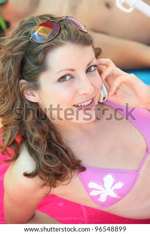 girl making call at the beach