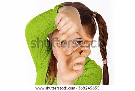 girl, making frame with hands, taking picture with imaginary camera, selective focus - stock photo