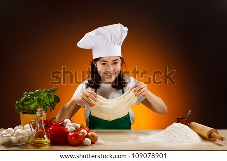 Girl making pizza dough - stock photo