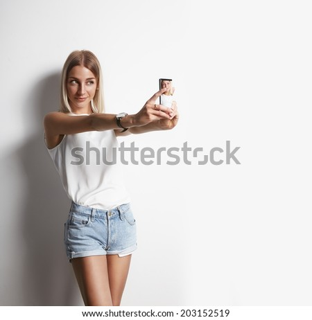 girl making selfie with a mobile phone - stock photo