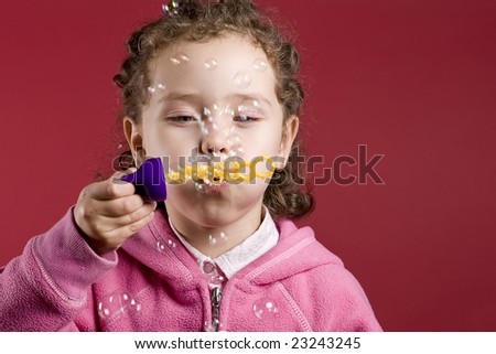 girl making soap bubbles