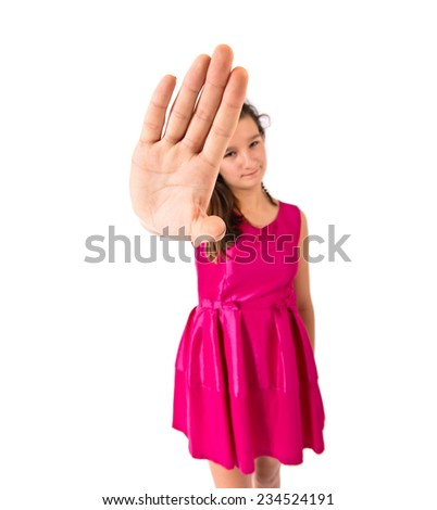 Girl making stop sign over white background   - stock photo