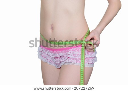 Girl measures her waist size - stock photo