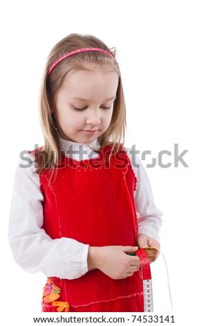 Girl measures her waist with measuring tape isolated on white