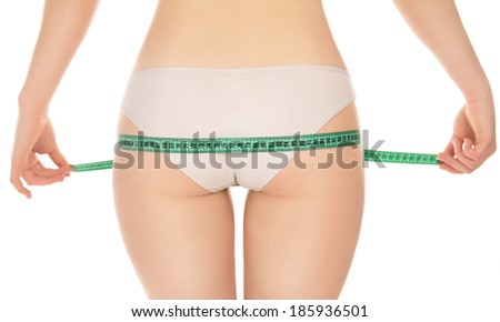girl measures its hips isolated on white background - stock photo