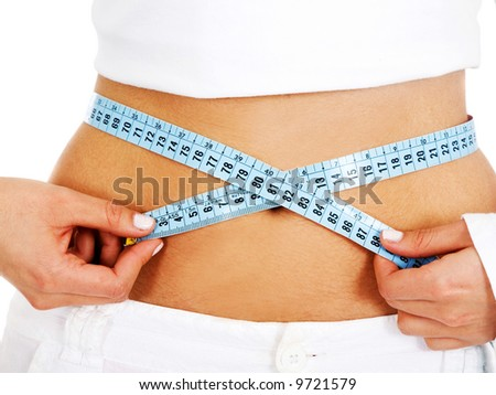 girl measuring her waist checking if she has had any weight loss - isolated over a white background - stock photo