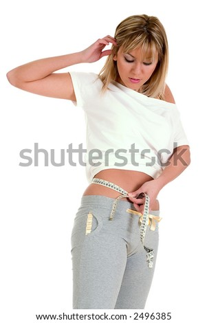 Girl measuring shes belly - stock photo