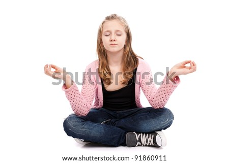 Girl meditating isolated on white background - stock photo