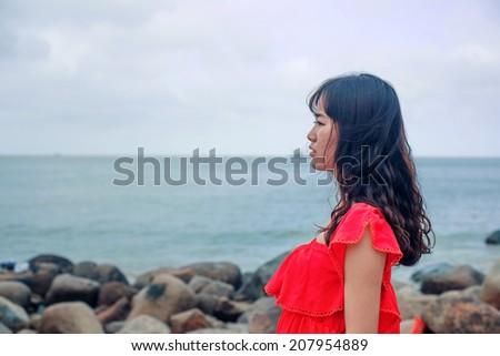 Girl meditation at the beach - stock photo