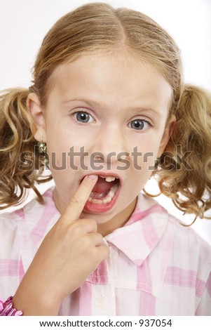 Girl missing tooth - stock photo