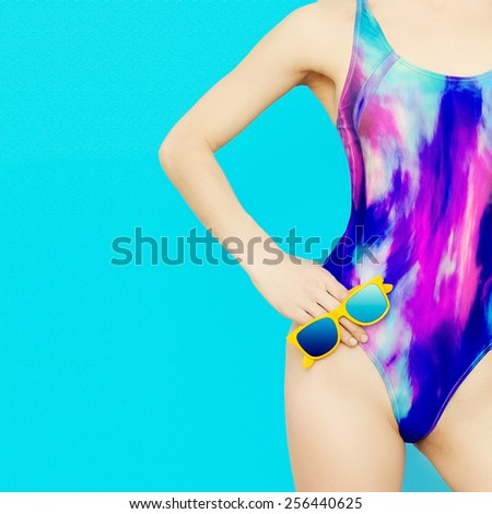 Girl Model in bright fashionable Swimsuit on blue background - stock photo