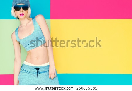 Girl model on bright background. Fashion Sports Style - stock photo