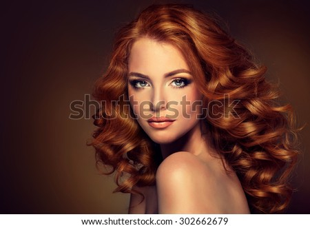 Girl model with long curly red hair . Trendy image of a red head woman - stock photo