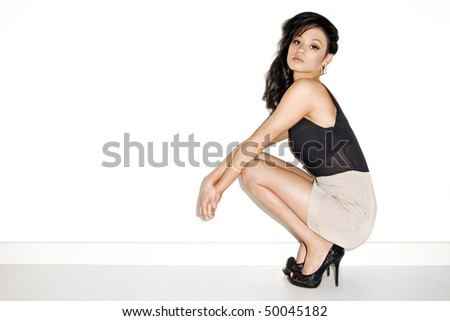 girl modeling a dress on a white background - stock photo