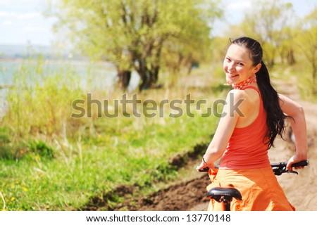 Girl mountain biking - stock photo