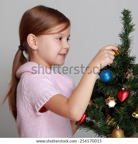 girl near a Christmas tree - stock photo