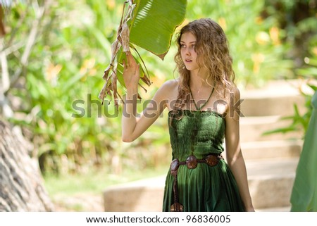 Girl near palm tree - stock photo
