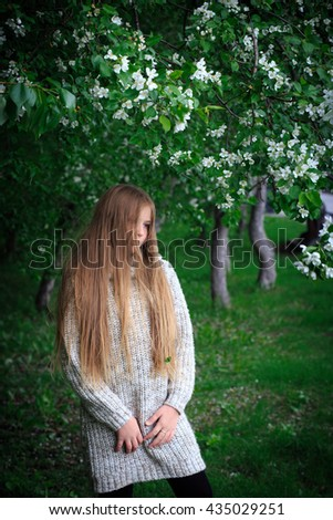girl near the apple tree - stock photo