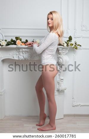 Girl near the fireplace  - stock photo