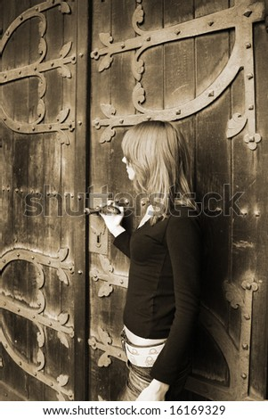 girl near the old fashioned door (colored sepia)