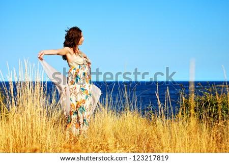 Girl near the seaside  enjoying summer - stock photo