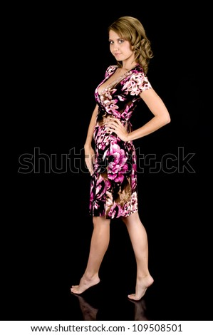 Girl-next-door beauty in barefoot in colorful spring dress. - stock photo
